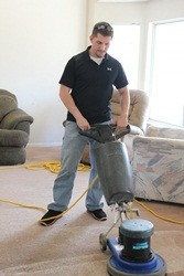 Justin using our Clark floor machine to clean carpets.